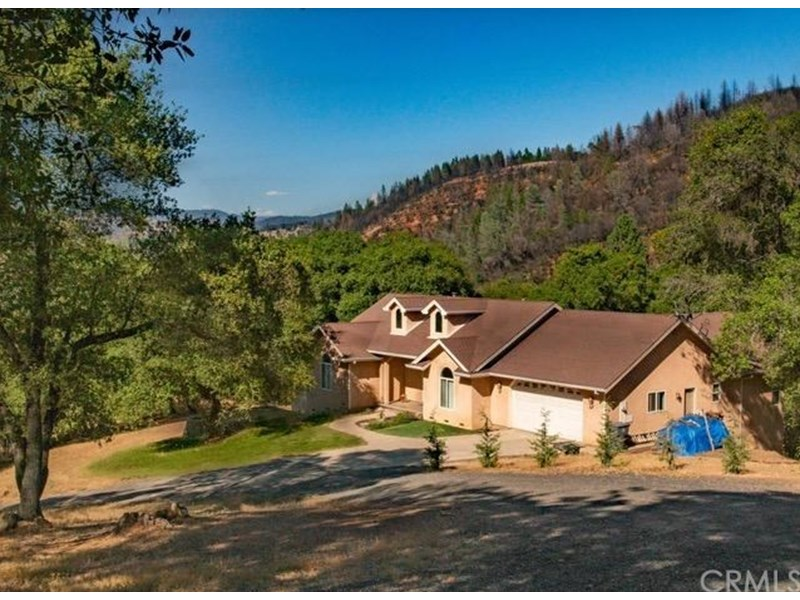 Beautiful Custom 3/2 Home nestles on a hill above a very private 12.6 Acres Lot.... Very close to Lake Oroville and Table Mountain State Park.. The Ultimate Outdoor Lover's Retreat!!! Homes is in Turn key condition with many upgrades...