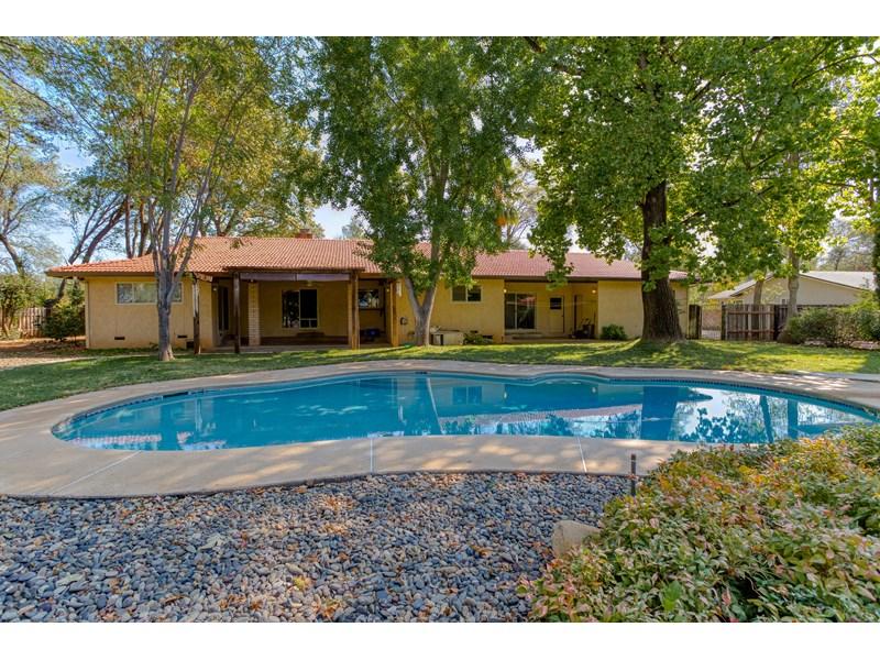 Custom Home with Pool & Shop